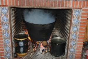 A cauldron of boiling water is used to skin the animal
