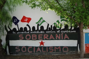 A wall mural declares ´Sovereignty and socialism´